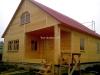 Каркасный дом с кровлей из металлочерепицы
